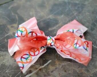 Peach orange peace sign hair bow
