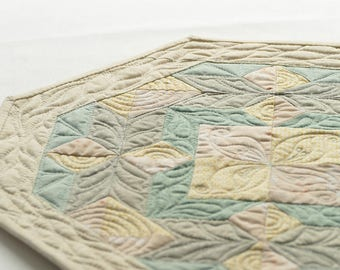 Octagon shaped mini quilt, table topper, soft coloured table accessory, mini quilt