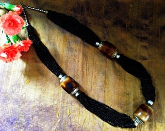 Multi strand black necklace, glass and wood bead necklace, huge wooden beads, tortoiseshell effect, statement necklace, seed beads necklace
