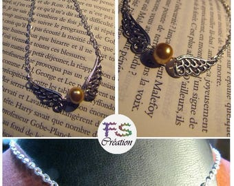 Golden snitch necklace, silver chain.