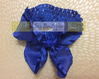 Blue ruffled bow with crochet band