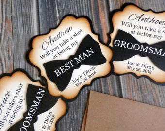 Groomsman Proposal Card / Suit Up. Your serviCe is required as / Will you take a shot at being my / Best Man / Groomsman / Usher