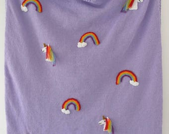 Rainbows and unicorns knitted lilac blanket with crochet appliques