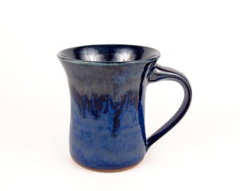 Handmade ceramic mug in a shiny jewel blue with a beautiful dark blue on the rim