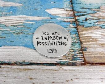 Aluminium good luck token/charm/pocket token/promise token/motivational coin. You are a rainbow of possibilities.