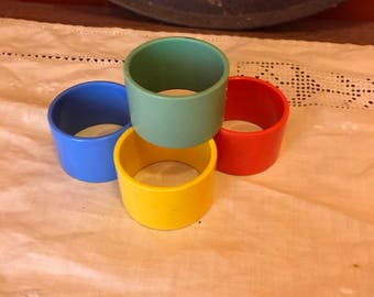 Set of 4 bright vintage plastic napkin rings bakelite