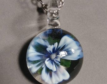 White and blue flower pendy, 2in long 1.5 in wide.