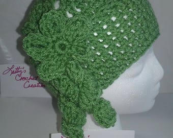 Hat with green flower