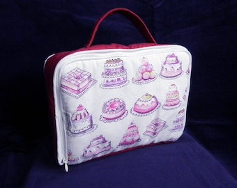 Pink padded suitcase printed cakes.