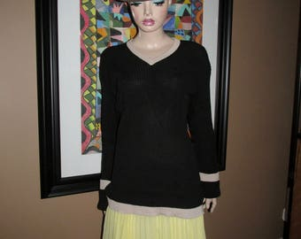 Vintage  Dolce&Gabbana pullover.Black knitted pullover with beige hem and cuffs.