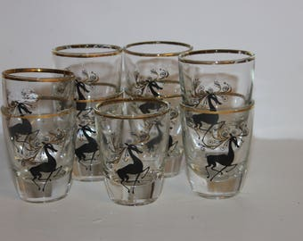 Set of 9 Christmas reindeer shot glasses, black and gold, mid century, Hollywood Regency, Mad Men