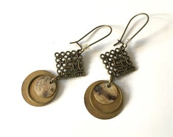Drop earring, brass and mother of Pearl charms. Small beads.