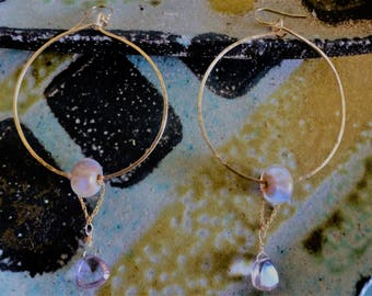 Amethyst Draped Hoops are gold hoop earrings sliding opalescent Art beads trailing precisely faceted Amethyst trillions on gold wheat chain.