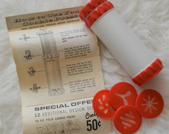 Vintage red and white cookie press