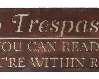 NO TRESPASSING sign in auburn patina