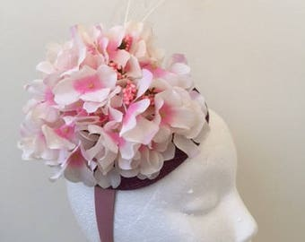 Pretty pink hydranger fascinator on a purple sinamay base with white feathers!
