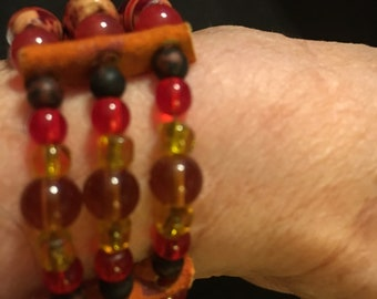 Native American tribal bracelet made with wood and glass beads.