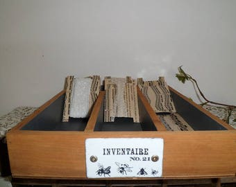 Antique drawer and its 12 tags with lace