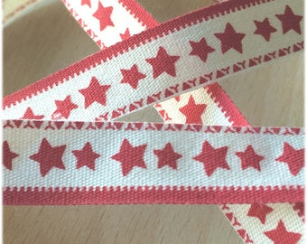 """decorative Ribbon: """"red star with border"""" on an ecru background"""
