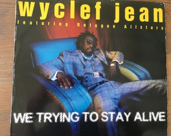 Wyclef Jean featuring Refugee All Stars- We Trying To Stay Alive - vinyl record