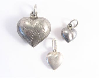 Three Vintage Sterling Puffy Heart Charms