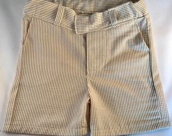 Boys tan stripe, gray stripe, or navy stripe seersucker shorts. Seersucker shorts available in boys sizes 12 months through size 7 boys