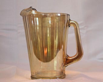 "Glass Pitcher ~ Carnival Glass/Iridescent Peach/Amber/Marigold/Luster ~ 7.5"" Tall ~ Holds 7.5 cups"