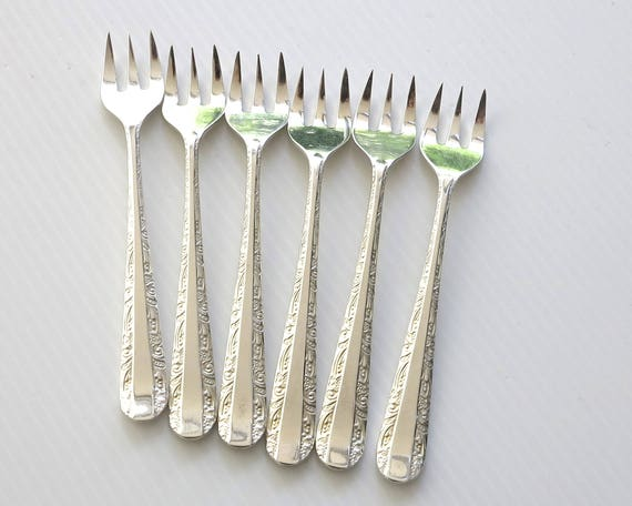 6 silver plated seafood forks / cocktail forks with upturned prongs, Rodd brand, Nemesia pattern, embossed floral pattern, Australia, 1950s