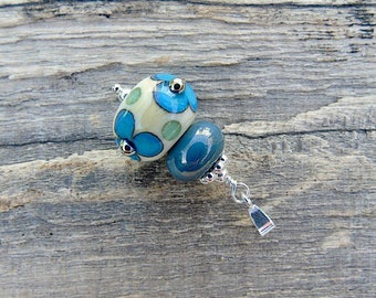 Ivory & turquoise lampwork glass pendant with sterling silver bail.