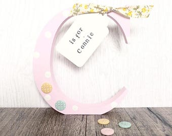 Freestanding girls personalised initial letter with wooden luggage tag. New Baby, christening gift. Nursery birthday