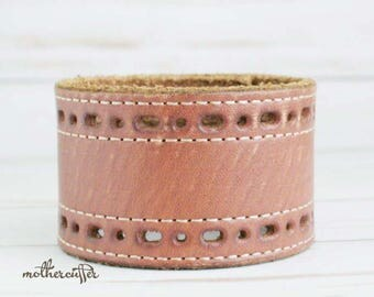 CUSTOM HANDSTAMPED wide brown leather cuff with cut out design by mothercuffer