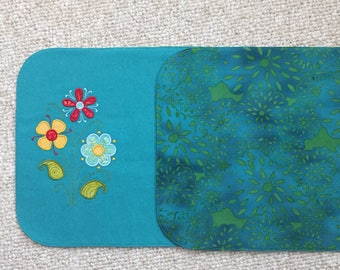Teal denim machine embroidery placemats. Reversible with teal batik on back