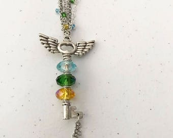 "25"" yellow, green, and blue Swarovski crystal key necklace"