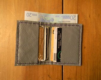 Grey leather card holder stitched purple thread