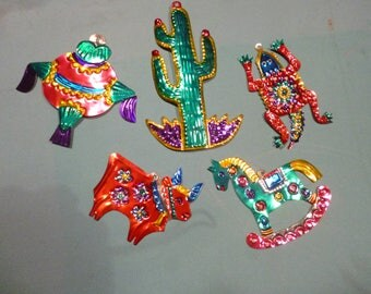 Five tin hand painted birds from Mexico.  Can be used as Christmas tree decorations.