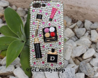 Make up lover bling phone case with a metal mascara, lipgloss, eyeshadow palette and a Dior perfume with clear, AB and pink crystals