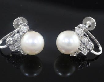 A Pair of 1960s screw back Diamond and Cultured Pearl Earrings, Pearl Earrings, Diamond Earrings
