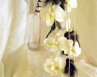 Orchids and feathers to personalize fall bouquet