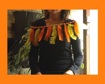 Finery of feathers, to rest on shoulders, feathers and sculptured wooden pearls, in harmony of yellow and orange