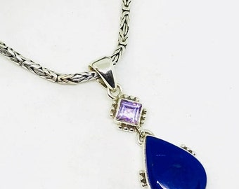 10% Lapis lazuli and amethyst pendant, set in sterling  silver (92.5) .Length 2 inches long. Natural lapis and amethyst stones.