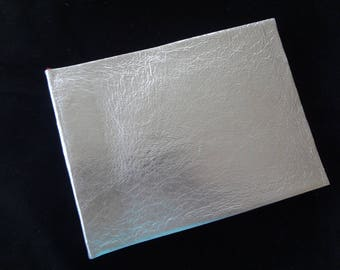 Silver leather covered photo album
