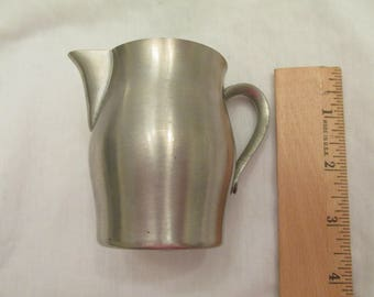 Vintage small pewter International Silver pitcher