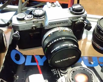 Olympus Collection OM 10 Camera, 5 lenses, Auto Winder, Flash, Booklets,  and more  ----- FREE Shipping