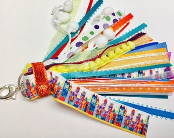 Its a Small World Tassel Keychain Party Gift Sticker
