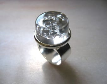 Clear resin and bursts of leaves silver ring