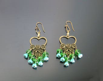 Soundtrack where heart is adorned with various green glass beads as a Peacock.