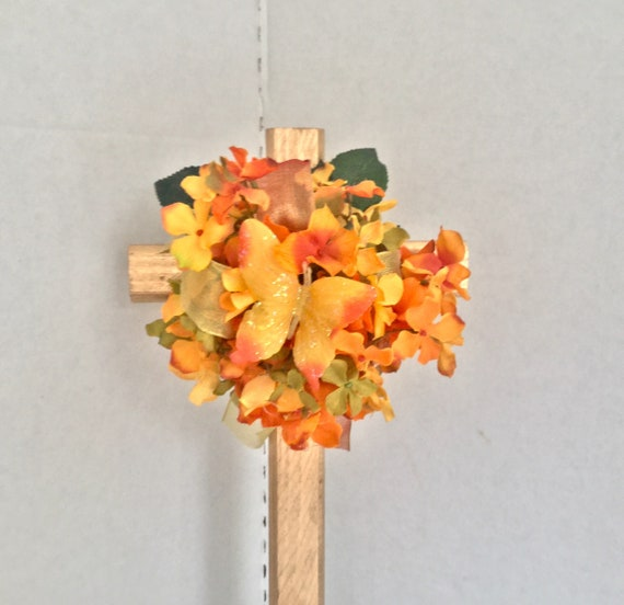 Cemetery flowers, Cemetery cross with flowers, grave decoration, memorial cross.