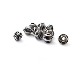 Set of 10 metal beads silver 6 x 7 mm