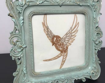Steampunk bird embroidery design framed. Victorian, vintage, steampunk framed embroidered bird.