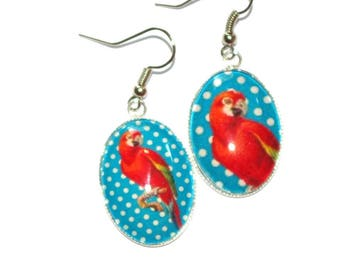 Earrings oval parrot on a background with dots
